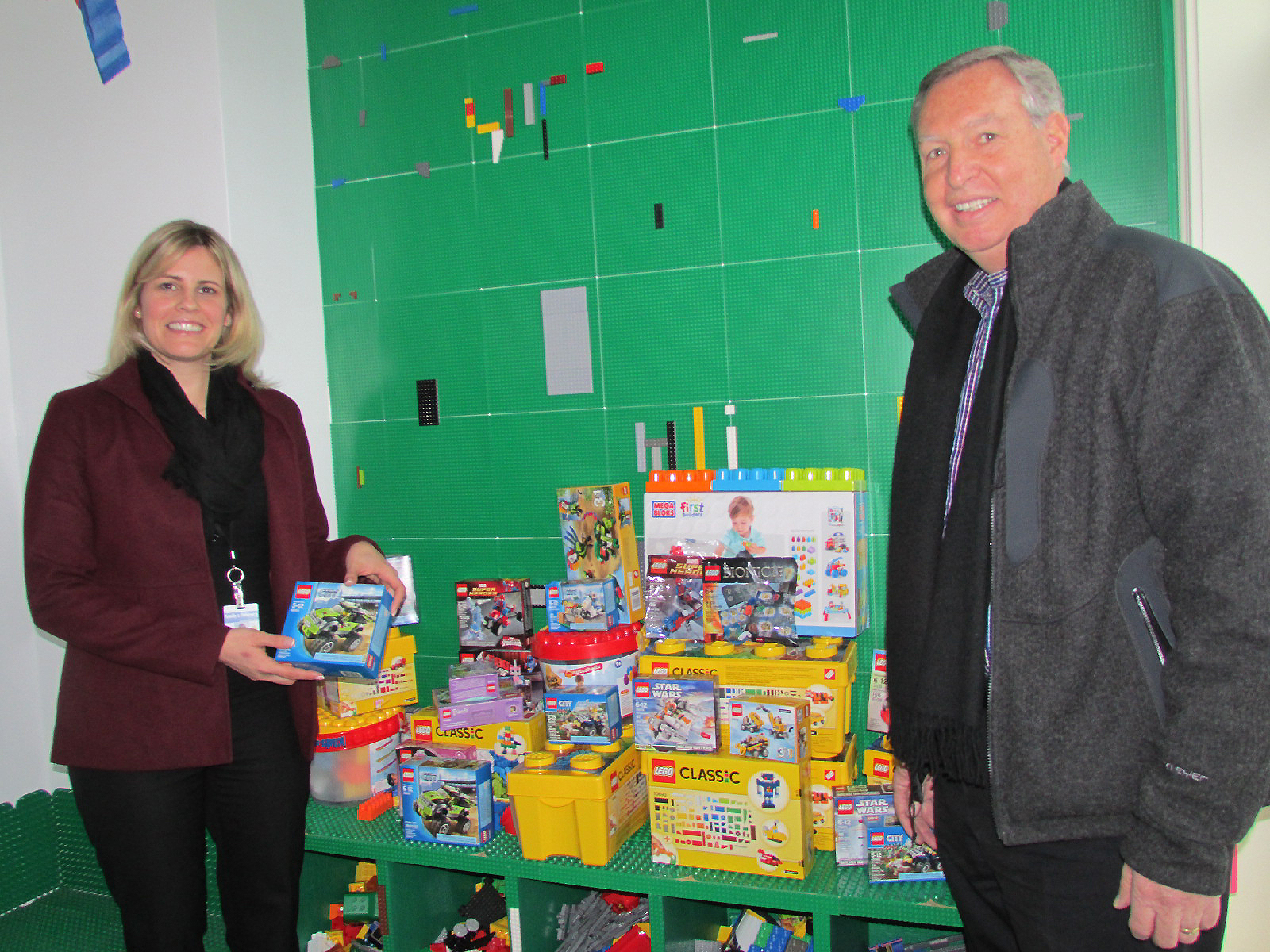 Apacet Senior Vice President Bob Fielding drops off two boxes of Legos donated by the staff of Ampacet